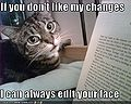 Funny-pictures-cat-threatens-to-edit-your-face.jpg