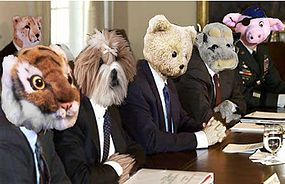 George Bush meets with his cabinet to work on a plan to spread freedom and love throughout the land.