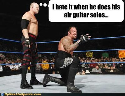 Funny-sports-pictures-kane-undertaker-air-guitar1.jpg