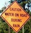 Sign-CautionWaterOnRoadDuringRain.jpg