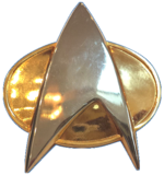 Starfleet Comm Badge (Star Trek TNG - White Background).png